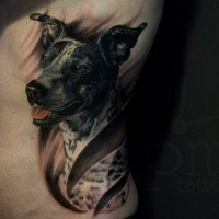 Realistic looking colored side tattoo of dog portrait