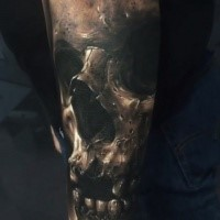 Realistic looking colored tattoo of creepy demon skull