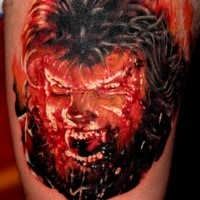 Realistic looking colored thigh tattoo of evil werewolf