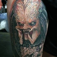 Realistic looking colored thigh tattoo of creepy Predator