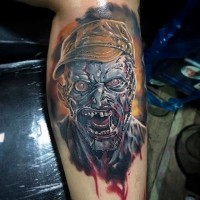 Realistic looking creepy bloody zombie face tattoo on arm