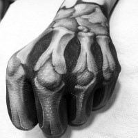 Realistic looking detailed hand tattoo of human bones