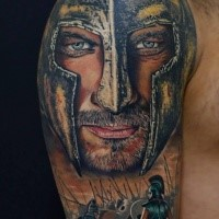 Realistic looking shoulder tattoo of medieval knight face with soldiers