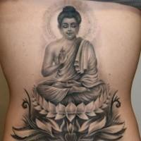 Realistic meditating buddha tattoo on back