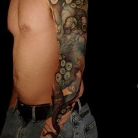 Realistic octopus tattoo on whole arm