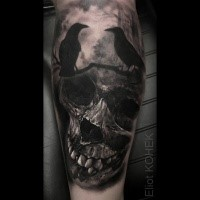 Realistic painted by Eliot Kohek tattoo of human skull with black crows