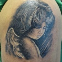 Realistic portrait of cherub girl tattoo