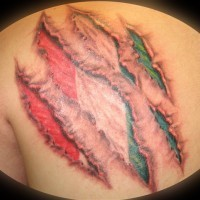 Realistic ripped skin italian flag tattoo