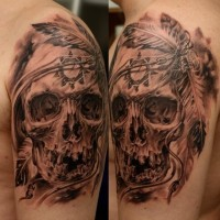 Realistic skull with native american symbols tattoo on shoulder