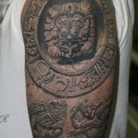 Realistic stone aztec tattoo on shoulder