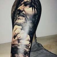 Realistic style black and white forearm tattoo of Jesus portrait and praying hands
