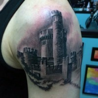 Realistic vintage photo like black and white big medieval castle tattoo on arm top