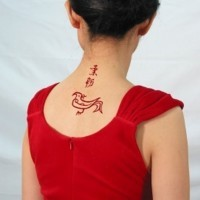 Red chinese symbol tattoo with bird