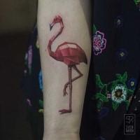Red colored forearm tattoo of big flamingo