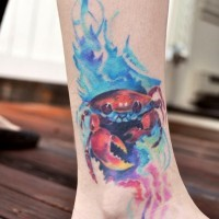 Red little crab tattoo in water