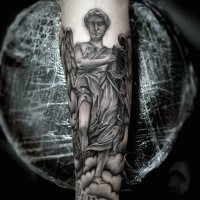 Religious style colored forearm tattoo of angel statue