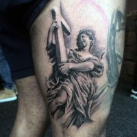 Religious style colored thigh tattoo of angel and cross
