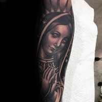 Religious style large sleeve tattoo of praying woman
