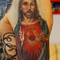 Religious themed colored shoulder tattoo of Jesus