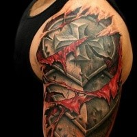 Ripped skin style colored shoulder tattoo of medieval iron armor