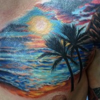 Romantic style colorful ocean sunset with palm trees tattoo on chest