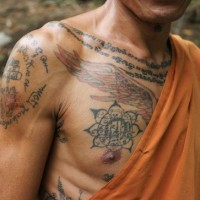 Sacred buddhist tattoo on chest