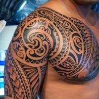Sacred polynesian tattoo on shoulder