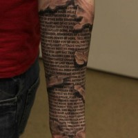 Sacred texts under skin rip forearm tattoo
