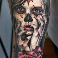 Sad beautiful santa muerte girl and dark red rose tattoo on arm