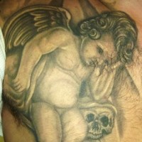 Sad cherub with skull tattoo