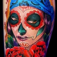 Santa muerte girl with a blue bandage on hair and red roses tattoo