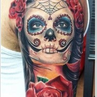 Santa muerte girl with big red rose tattoo