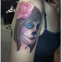 Santa muerte with pink flower in hair tattoo on arm