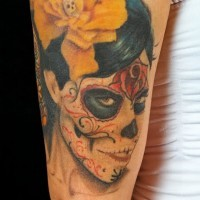 Santo muerte girl with a yellow rose tattoo
