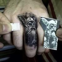 Scandinavian god odin tattoo on finger