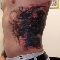 Scary gargoyle tattoo on ribs for men