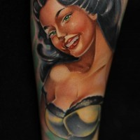 Seductive smiling brunette pin up girl colored old school style tattoo