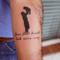 Sentimental dark black figure with baby memorial tattoo with touching lettering arm tattoo