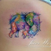 Sentimental mother and baby elephant colored tattoo on woman's side in watercolor style by Javi Wolf
