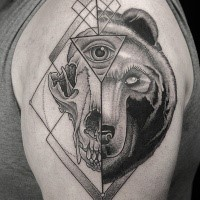 Separated black ink dot style shoulder tattoo of animal skull with bears head