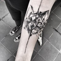 Separated black ink forearm tattoo of cat head by Inez Janiak