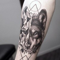 Separated black ink forearm tattoo of half geometrical half realistic wolf