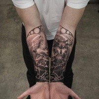 Separated dot style forearm tattoo of wolf with strange circle shaped ornaments