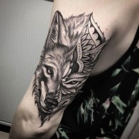Separated original designed arm tattoo of wolf face stylized with ornaments