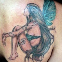 Sexy fairy tattoo on shoulder blade