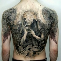 Shaman and wings tattoo on back