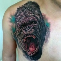 Sharp designed and detailed colored roaring gorilla tattoo on chest