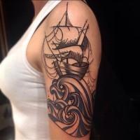 Ship on waves tattoo on half sleeve