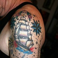 Shoulder oldschool tattoo with ship and stars