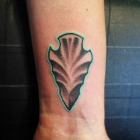 Simple 3D like colored antic arrow head tattoo on wrist